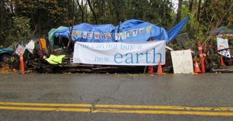 burnaby mountain camp with earth banner