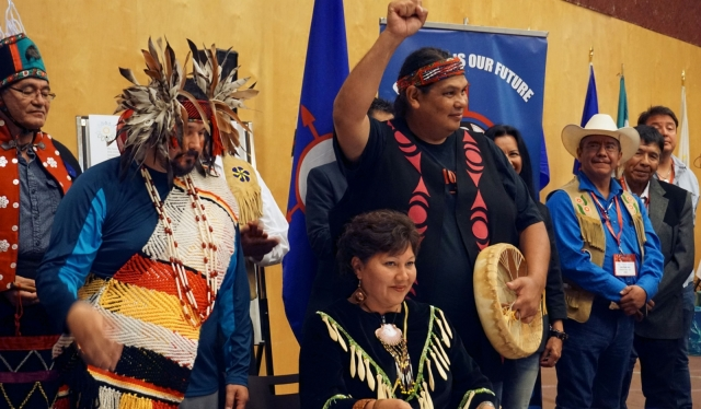 Tsleil-Waututh leaders (left to right) Gabriel George, Charlene Aleck and Rueben George sign the Treat Alliance Against the Tar Sands in Vancouver on Thurs. Sept. 22, 2016. Photo by Elizabeth McSheffrey.