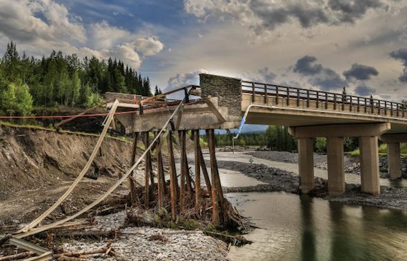 A bridge damaged by devastating floods in Alberta, Canada, in 2013. (Gregg Jaden via Flickr)